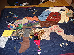 Quilted map of Theah.    Each province has its own fabric.  This was made mostly as a prototype - I hope to do a better pieced one eventually.